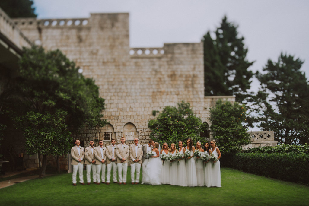 Dubrovnik Villa Argentina group photo: groom and bride party taking a beautiful photo together after the wedding ceremony