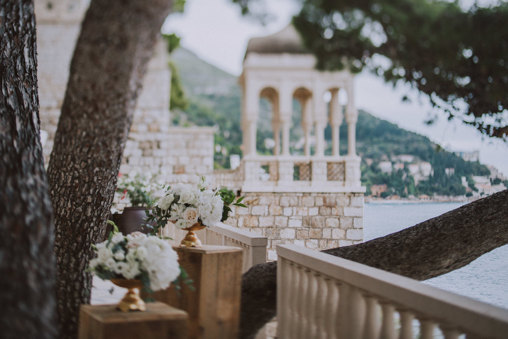 Dubrovnik wedding reception at hotel Villa Argentina terrace overlooking Villa Sheherezade. It is possible to see a few flower arrangements.