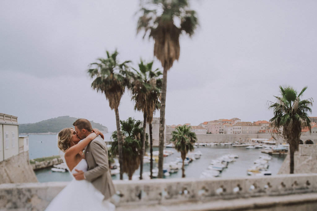 The gorgeous wedding couple at their photosession after the ceremony with a Croatian wedding photographer. Rainy weather doesn't matter!
