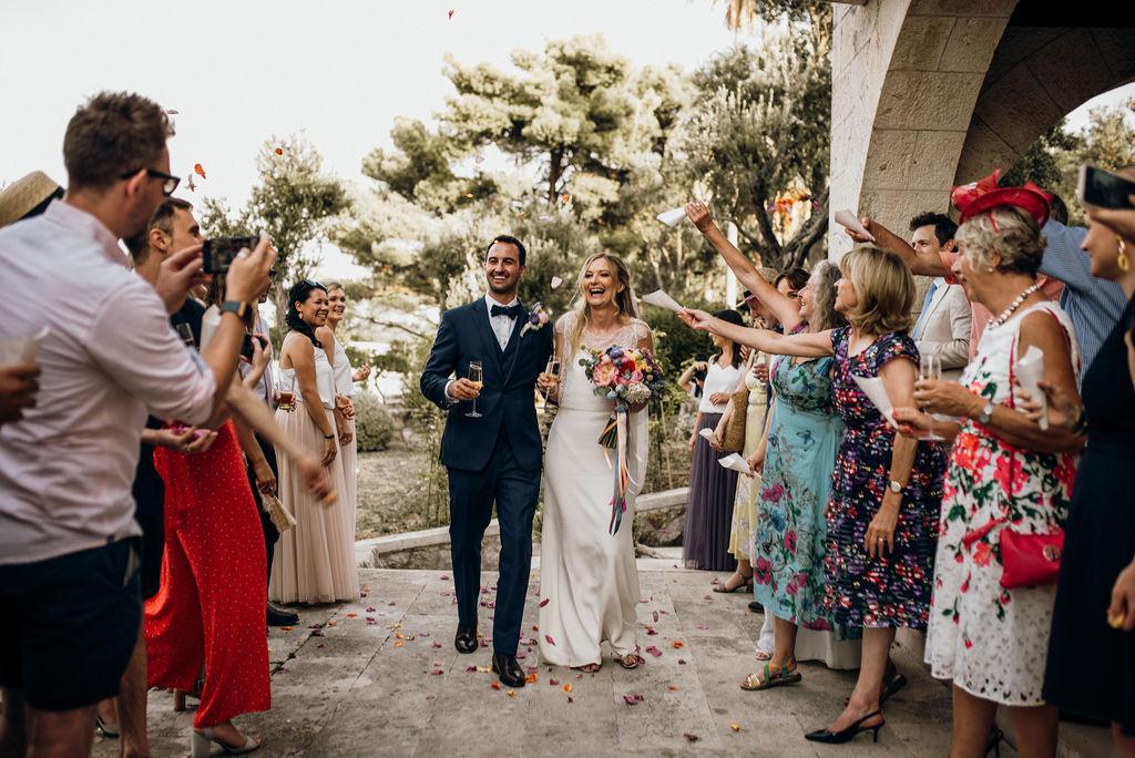 Couple arriving to their Dubrovnik wedding reception at Villa Ruza on Kolocep island, stunning photo by De Botanika weddings!